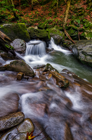 small cascades on the forest river among huge boulders covered with moss. dreamy Carpathian landscape Stock Photo - 77096980