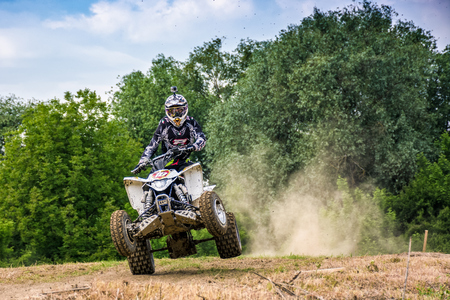 ATV Rider in Dirt Bike Jumping action. TransCarpathian regional Motocross Championship Editorial