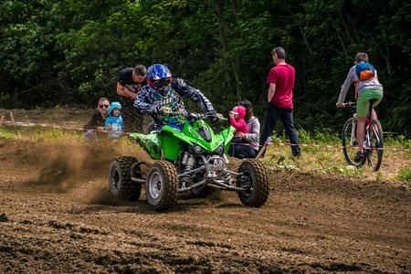 ATV Rider accelerating in dirt track. TransCarpathian regional Motocross Championship