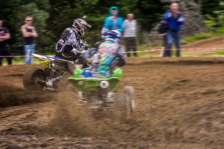 ATV Rider in the action. Off-road extreme cornering in dust. TransCarpathian regional Motocross Championship Editorial