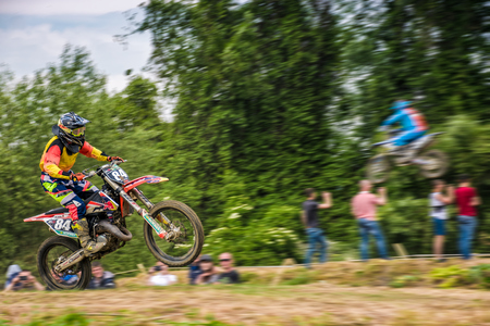 Uzhgorod, Ukraine - May 21, 2017: Extreme enduro MOTO SPORT Rider in the action. Motion blur with flying dirt. TransCarpathian regional Motocross Championship Stock Photo - 78938781