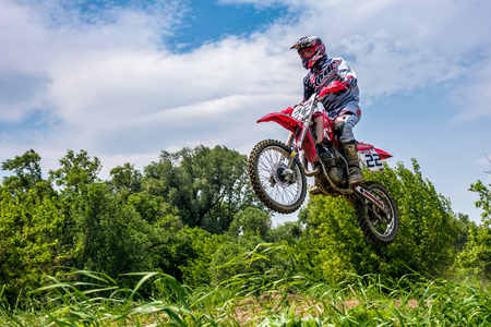 Uzhgorod, Ukraine - May 21, 2017: Off-road motorbike extreme Jumping. TransCarpathian regional Motocross Championship Stock Photo - 78938782