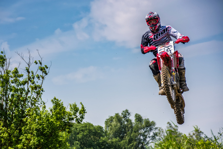 Uzhgorod, Ukraine - May 21, 2017: Off-road motorbike extreme Jumping. TransCarpathian regional Motocross Championship Editorial
