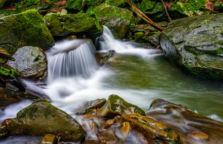small cascades on the forest river among huge boulders covered with moss. dreamy Carpathian landscape Stock Photo