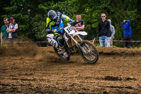 Enduro bike rider accelerating in dirt track.  TransCarpathian regional Motocross Championship