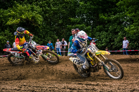 Extreme enduro MOTO SPORT. KTM racers turn on a corner in dirt. TransCarpathian regional Motocross Championship