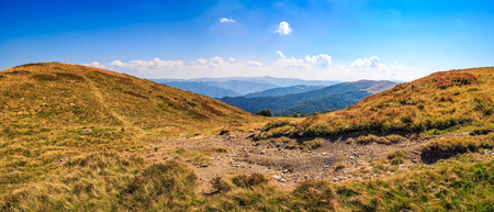 panoramic summer landscape. path through the meadow uphill to the mountain top Stock Photo