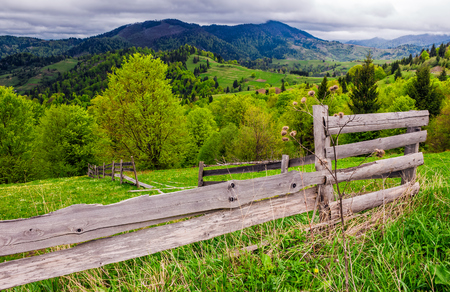 wooden fence on hillside in the rural area. classic countryside landscape of Carpathians Imagens