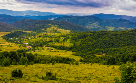 village in mountain valley. beautiful countryside summer landscape