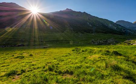 sunrise in valley of transfagarasan mountains. beautiful carpathian nature