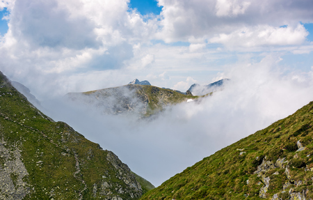 high mountain peak in clouds among the hills. majestic weather in carpathians
