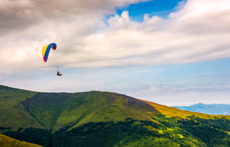 Skydiving flying in the clouds over the mountains. parachute extreme sport Stock Photo - 81707391