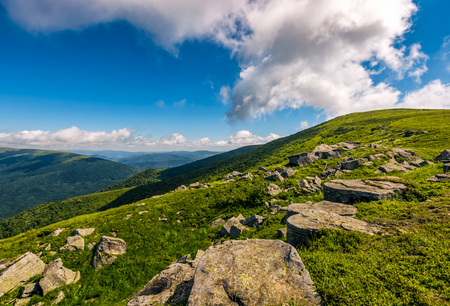 cloudy blue sky over the mountains with rocky hillside. gorgeous nature of Carpathian mountains