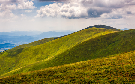 rolling hillsides of Carpathian mountain ridge. Beautiful nature background with cloudy sky Stock Photo - 81972175