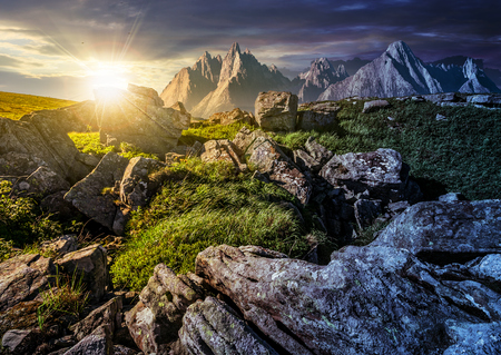 day and night time change concept over rocky peaks and rocks on hillside in High Tatras. Amazing composite landscape of mountain ridge