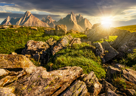 composite image of  rocky peaks and rocks on hillside in Tatras. Gorgeous sunset in summer mountain landscape