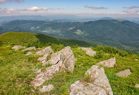 huge rocks on the edge of hillside. fine weather in summer mountain landscape. beautiful nature background 版權商用圖片