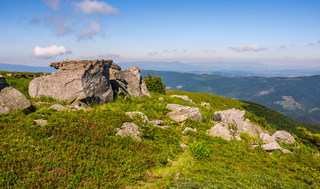 huge rocks on the edge of hillside. fine weather in summer mountain landscape. beautiful nature background Stock Photo