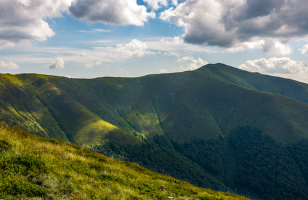 Carpathian Mountains with its peaks, hills and grassy meadows under the blue sky with clouds in summer day Stock Photo - 82900861