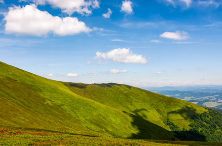 beautiful summer landscape in mountains. fine weather with blue sky and some clouds. gorgeous travel background with footpath through the mountain ridge Stock Photo