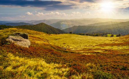 huge boulders on the edge of hillside. fine weather in summer mountain landscape at sunset Banco de Imagens