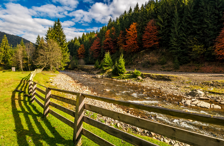 forest river near the road and camping place. beautiful mountainous landscape on fine autumn day