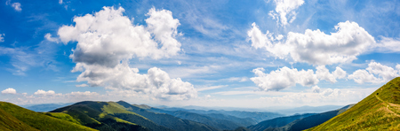 gorgeous cloudscape over the mountain ridge tops. amazing summer scenery in carpathian mountains