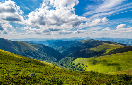 gorgeous cloudscape over the grassy hillside. gorgeous summer scenery in mountains Banco de Imagens - 83550553