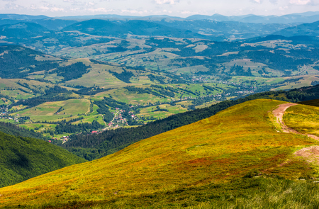 view of rural area from the high hillside. lovely summer landscape in Carpathian mountains