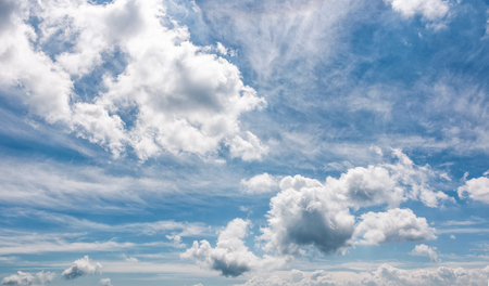 cloudy dynamic formation on a blue summer sky. dramatic weather background with beautiful cloud arrangement Stock Photo