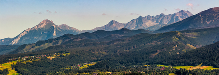High Tatra mountain ridge evening in Poland. View to gorgeous valley of Zakopane village