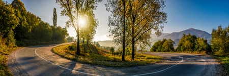 turnaround on serpentine in countryside area. bright autumnal sunrise in mountains Stock Photo