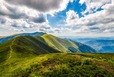 mountain ridge and valley in beautiful Carpathians. lovely mountainous scenery on cloudy summer day