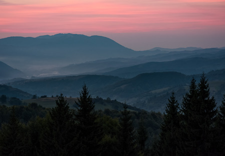 spectacular background of  landscape with reddish sky at dawn in mountains
