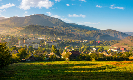 beautiful countryside of TransCarpathian town Volovets. spectacular early autumn scenery in mountains at sunrise Stock Photo