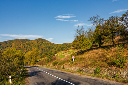 asphalt road in mountainous countryside. beautiful early autumn morning scenery
