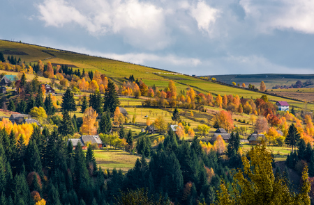 village on hillsides in mountains. beautiful countryside scenery with yellow trees