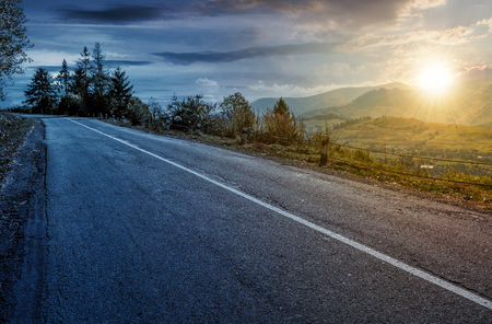 time change concept of countryside mountain road . lovely autumnal scenery Banco de Imagens