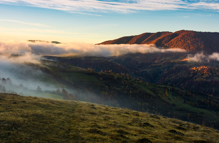 fog rolling over the hills at sunrise. stunning countryside autumnal background Stock Photo