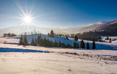 sun burst over the beautiful winter landscape. stunning scenery in Carpathian mountains Stock Photo