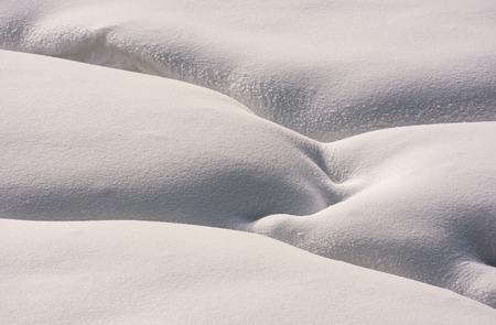 fancy snow layout on the ground. beautiful and unusual background Stock Photo