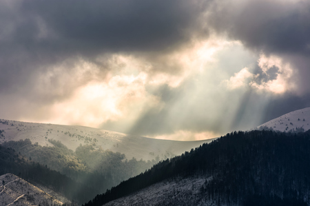 beams of light over the mountains. gorgeous scenery on a cloudy day in winter Stock Photo
