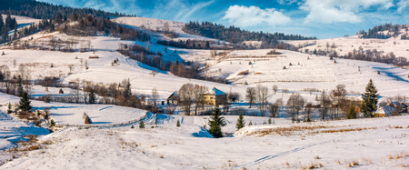 panorama of Carpatian village in winter. beautiful rural scenery in mountainous area