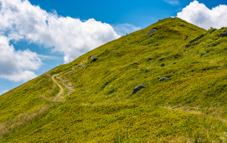 path uphill to the peak of mountain ridge. gorgeous summer nature scenery with cloudy sky. beautiful tourism background Stock Photo