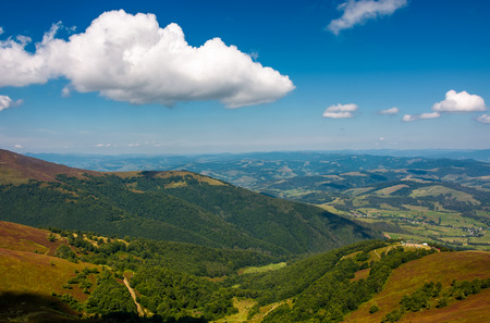 beautiful summer scenery in mountains. view down in to the valley from the top of a mountain Stock Photo