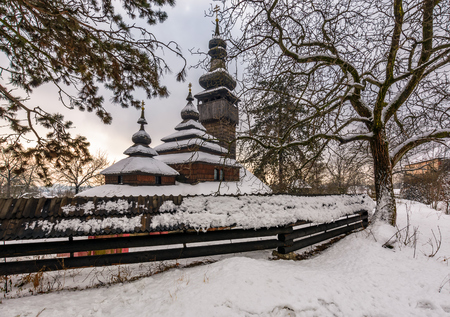 old orthodox wooden church in winter.