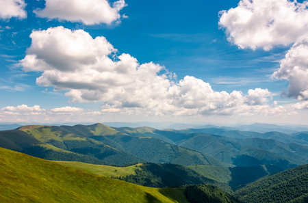 Carpathian mountain ridge with its spurs under sky with clouds. beautiful summer nature scenery Stock fotó