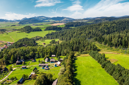 Slovakian town Stara Lubovna on forested hillside. beautiful rural scenery in mountainous area viewed from above on a summer day. Editorial