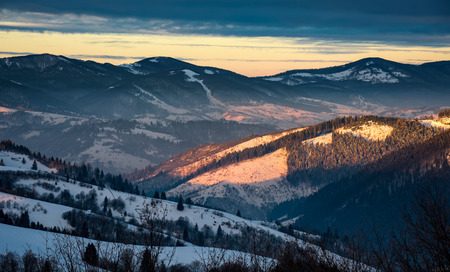 winter sunrise in Carpathian mountains. beautiful landscape with snowy hillsides Stock Photo