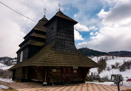 Uzhok, Ukraine - February, 25: Church of the Archangel Michael . old wooden building in Carpathian mountains in winter